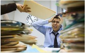 man with desk overwhelm